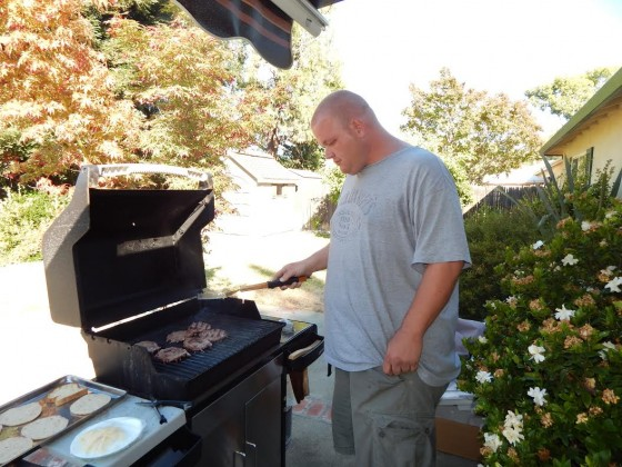 Carl's cooking up some no-antibiotics buffalo burgers from Trader Joe's.