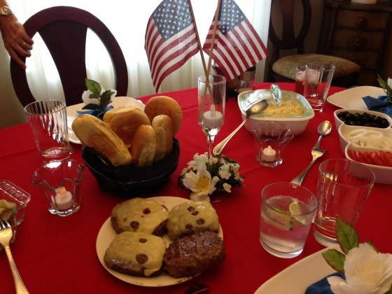 "Angela says: ""4th of July with no hormones or antibiotics, just pure grass fed beef.  Hot dogs were organic also.  Yeah!  Delicious!""  (Bonus points on that festive tablescape!)"